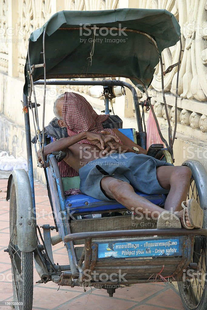Sleeping Cyclos Driver in Phnom Penh royalty-free stock photo