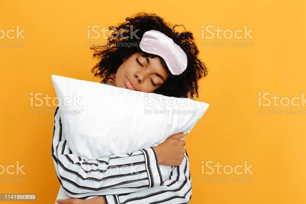 Sleeping dreams woman portrait afro american girl in pajama is a on picture id1141690899?b=1&k=6&m=1141690899&s=612x612&h=8uk1ajvm oguve6t4uhkbszbkiba2n1cjcys2adhiy8=