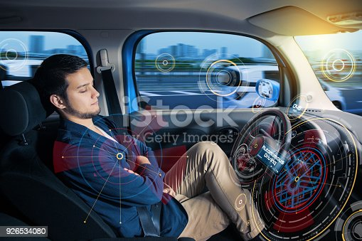 istock Sleeping driver in autonomous car. 926534080