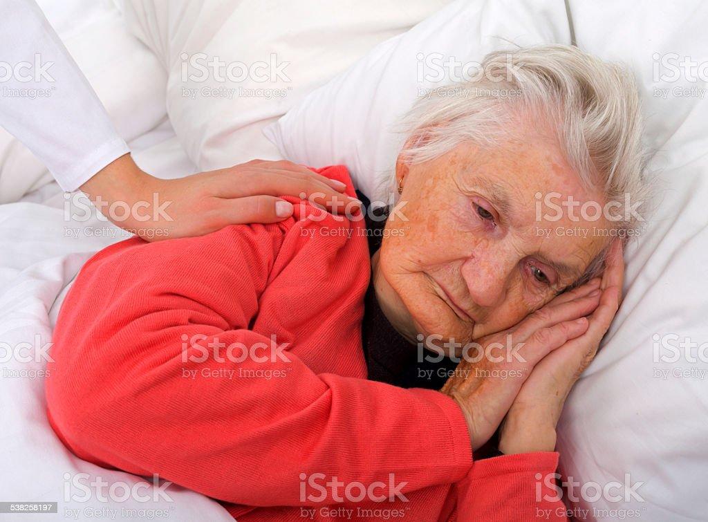 Sleeping elderly stock photo