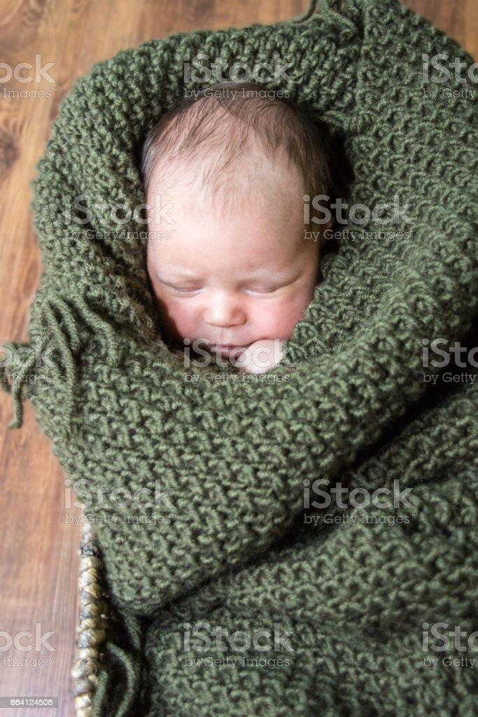 Sleeping handsome newborn boy wrapped in  blanket royalty-free stock photo