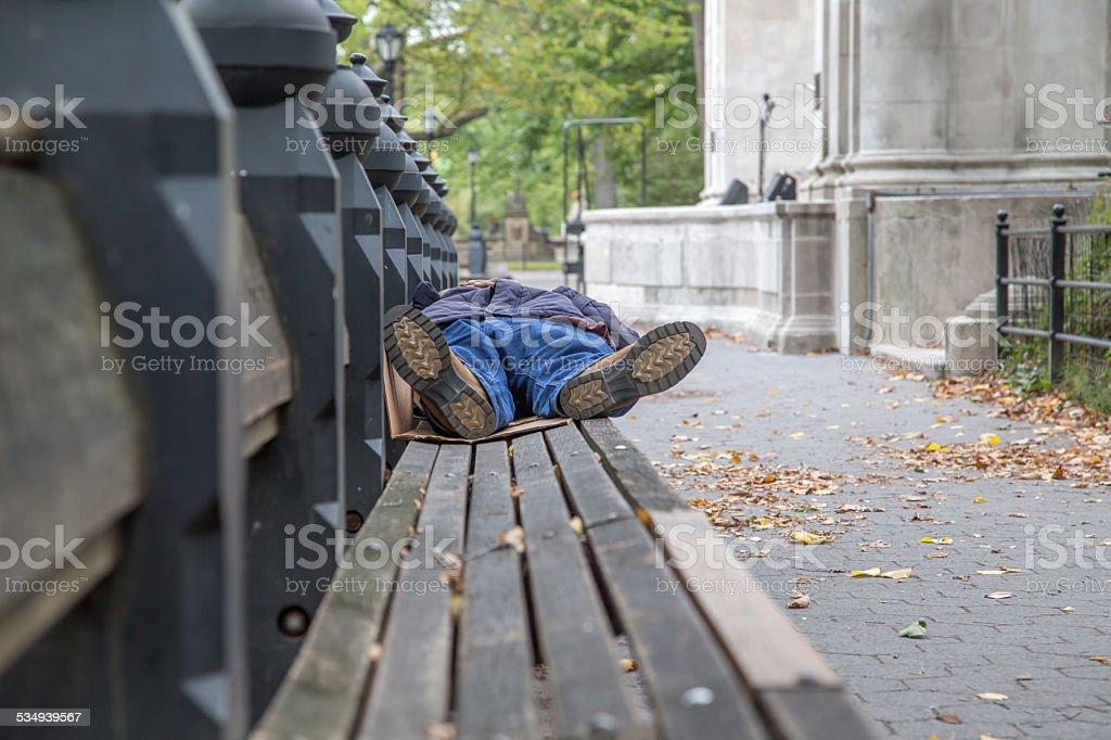 Sleeping homeless at the park stock photo