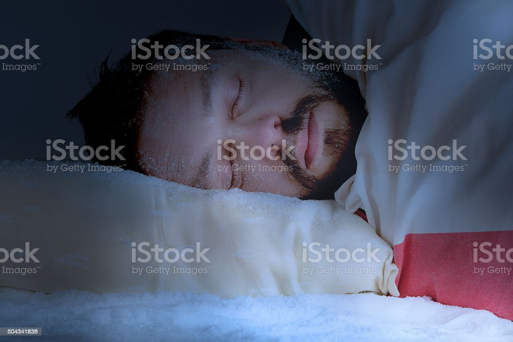 Sleeping in a cold room stock photo