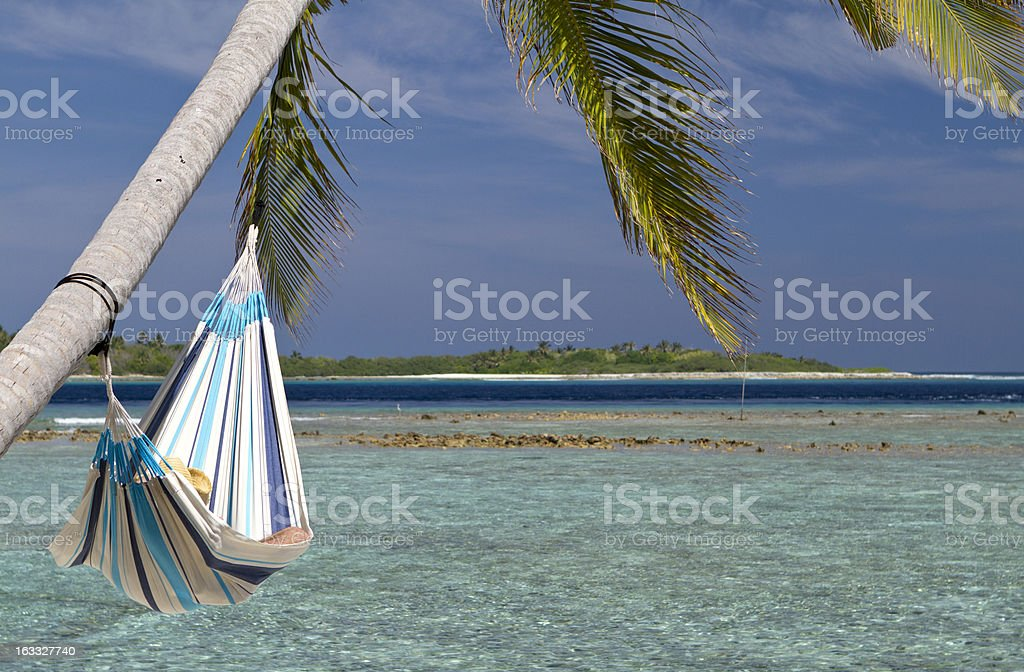 Sleeping in a hammock by the sea royalty-free stock photo