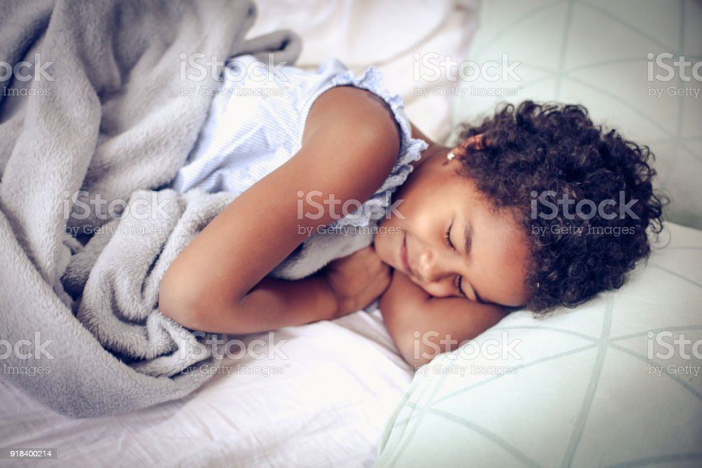 Sleeping in bed. stock photo