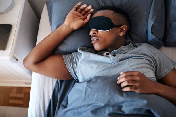 dormir es mi pasatiempo favorito - man sleeping fotografías e imágenes de stock