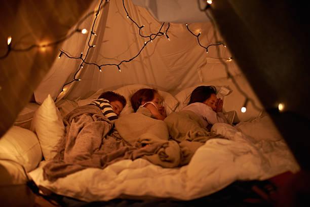 sleeping in our imaginary tent - fort bildbanksfoton och bilder