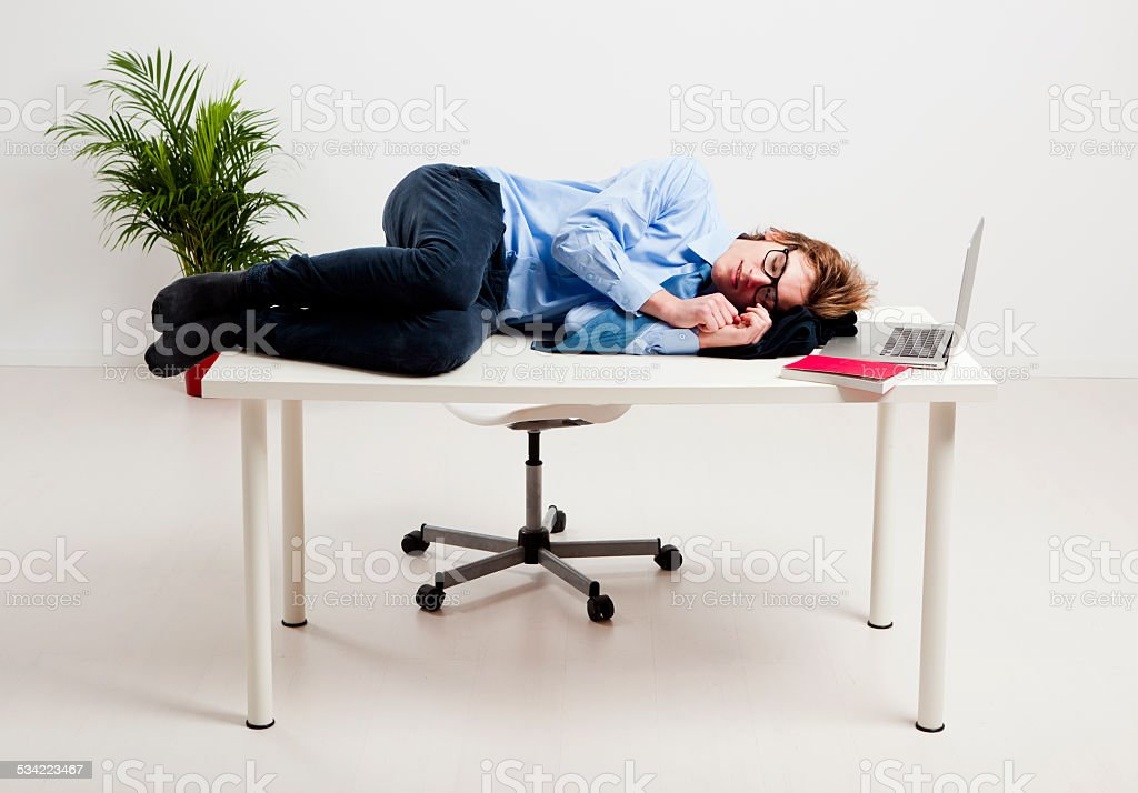 Sleeping in the office stock photo