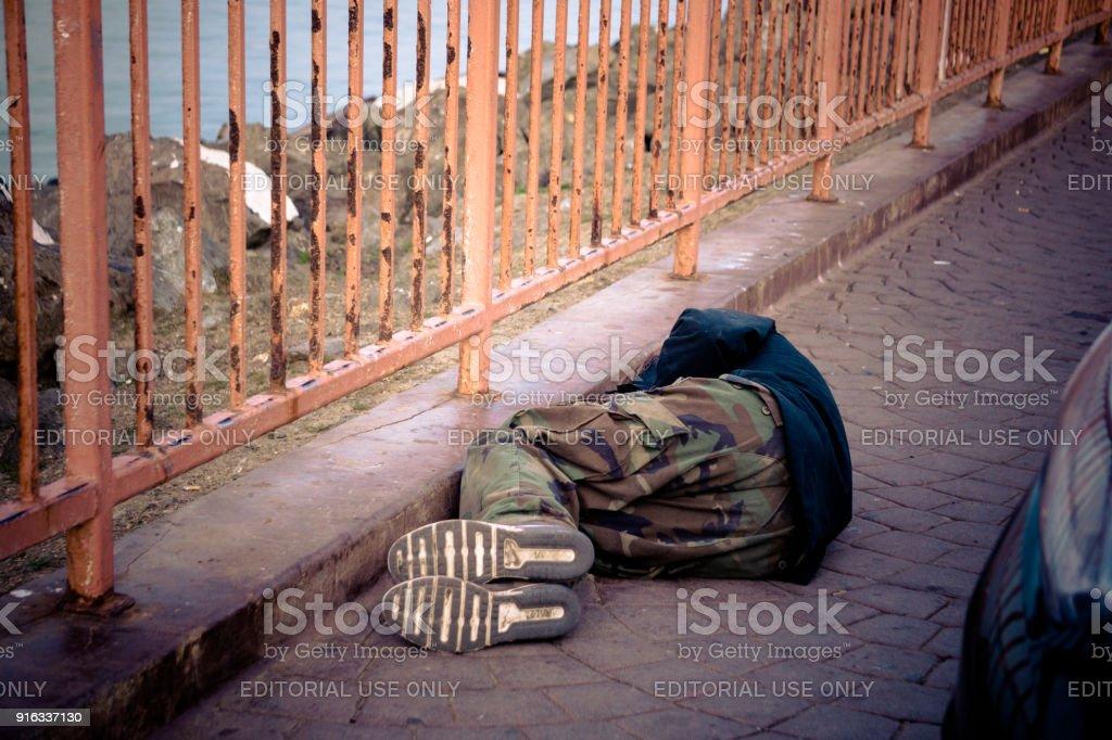 Sleeping in the street stock photo