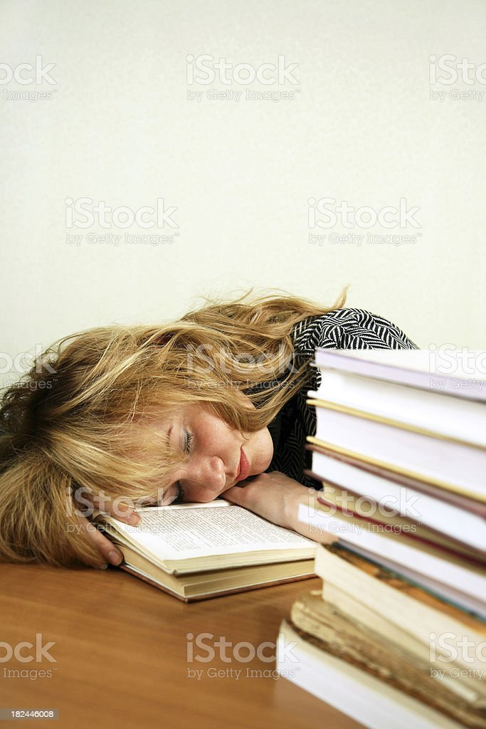 Sleeping instead of studying royalty-free stock photo