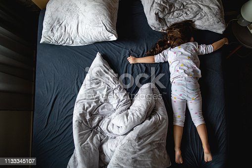Cute little four year old girl enjoying the stay at a luxurious apratment with her parents.