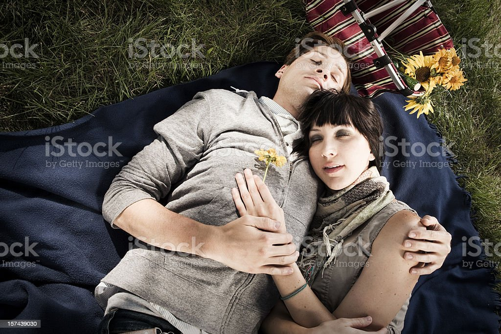 Sleeping lovers on a Summer Picnic royalty-free stock photo