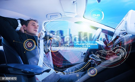 istock Sleeping man in the autonomous car. 913581670
