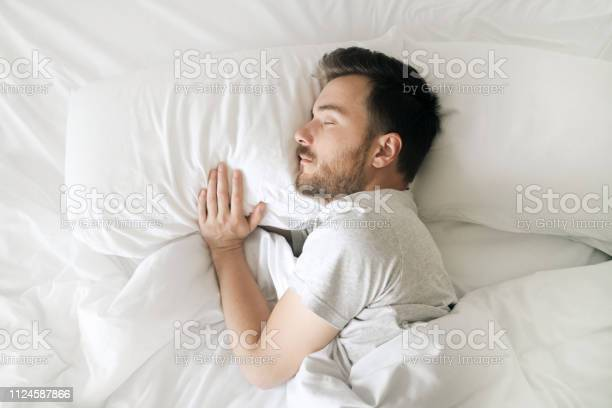 Sleeping man in white bed top view relaxed young bearded adult in picture id1124587866?b=1&k=6&m=1124587866&s=612x612&h=pvtfnol9qgkygv1u8w iv48jfmht gj2hhcxtu  zs4=