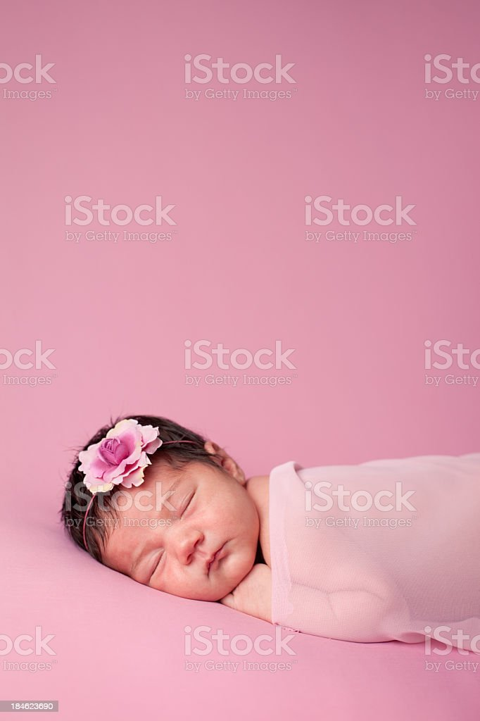 Sleeping Newborn Baby Girl on Pink Background With Copy Space royalty-free stock photo