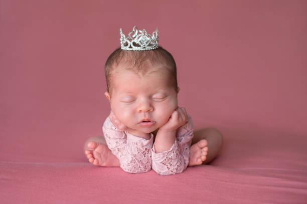 Sleeping Newborn Baby Girl Wearing a Tiara stock photo