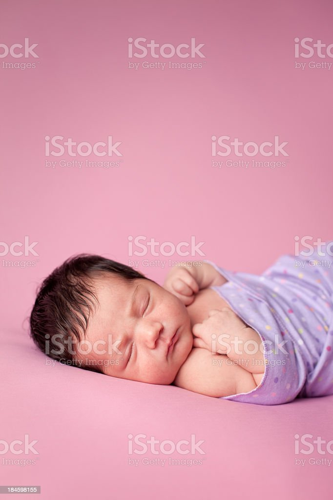 Sleeping Newborn Baby Girl Wrapped in Blanket With Copy Space royalty-free stock photo