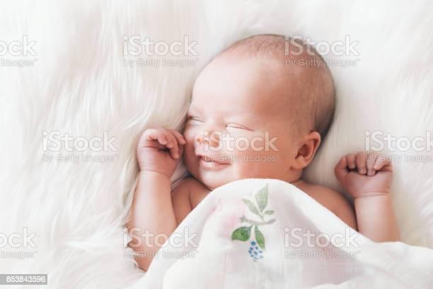 Sleeping newborn baby in a wrap on white blanket picture id853843596?b=1&k=6&m=853843596&s=612x612&h=rfmlwb0y3lsr66bwxqyzi7gwudh o4 wxrzq m03uec=