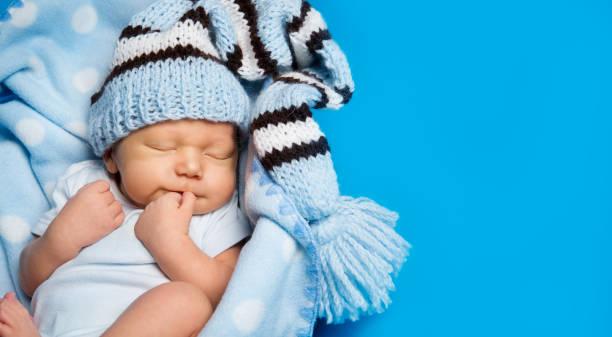 Sleeping  Newborn Baby, New Born Kid Boy Sleeping In Woolen Hat stock photo