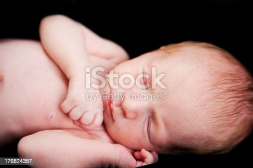 Note: Extremely shallow depth of field.A newborn baby sleeping peacefully.