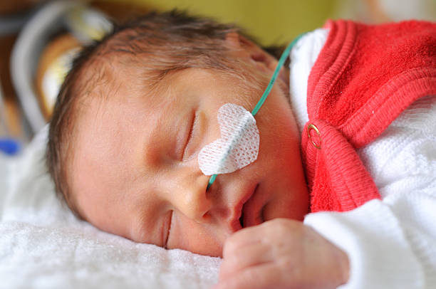 Sleeping newborn baby Sleeping newborn baby neonatal intensive care unit stock pictures, royalty-free photos & images
