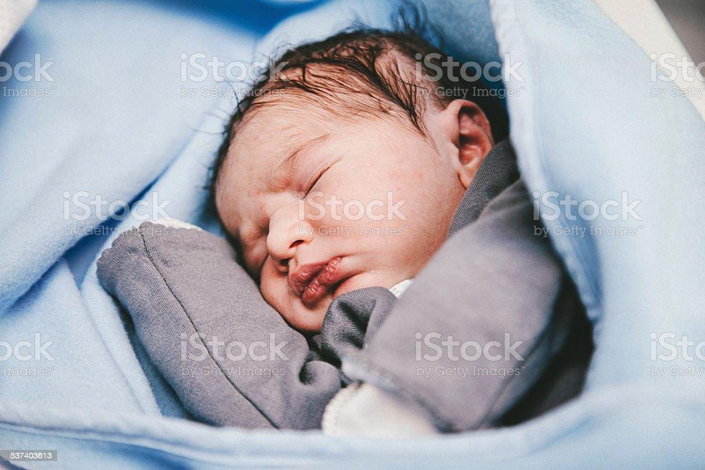 Sleeping newborn baby stock photo