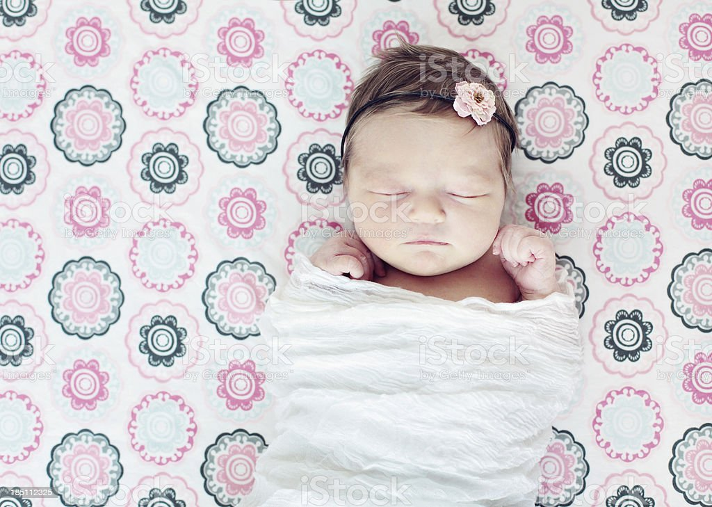 Sleeping Newborn in crib stock photo