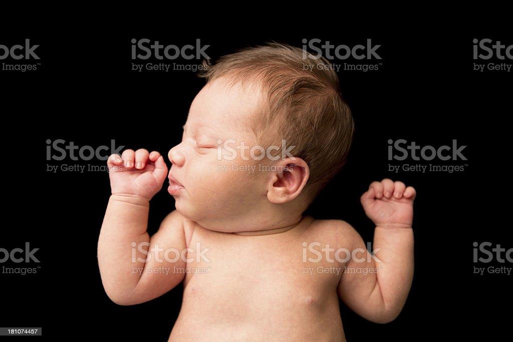 Sleeping Newborn Lying on Back, With Black Background stock photo