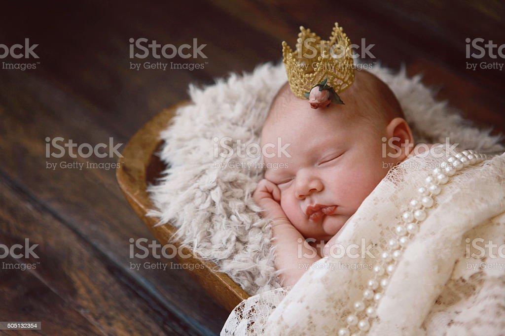 Sleeping Newborn Princess stock photo