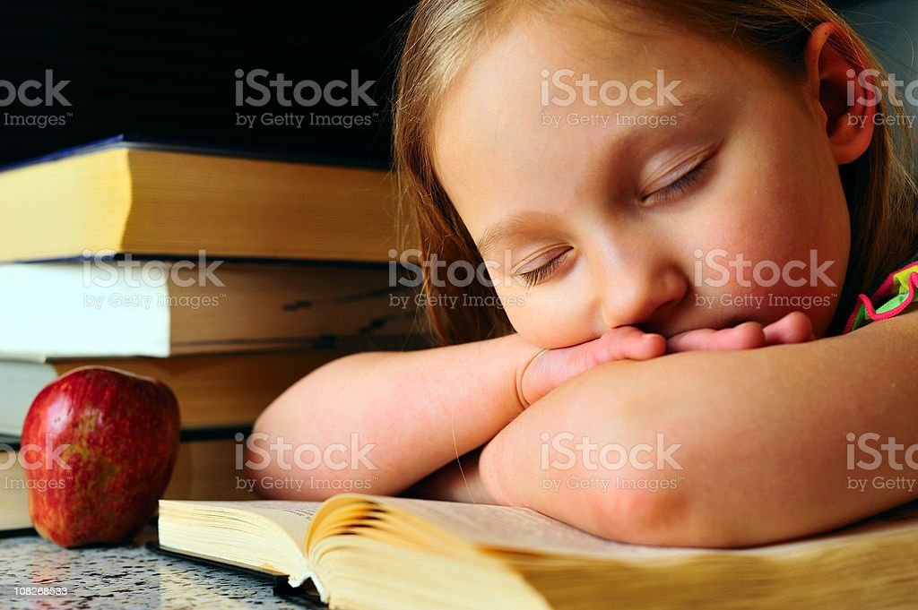 Sleeping on a book royalty-free stock photo