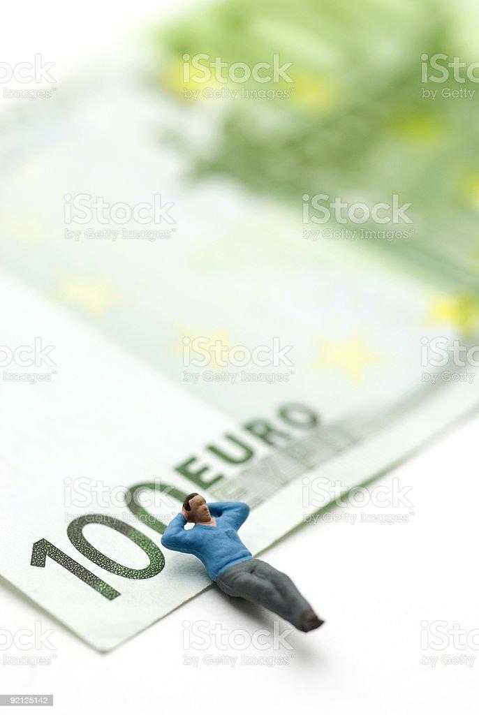 sleeping on Euros royalty-free stock photo