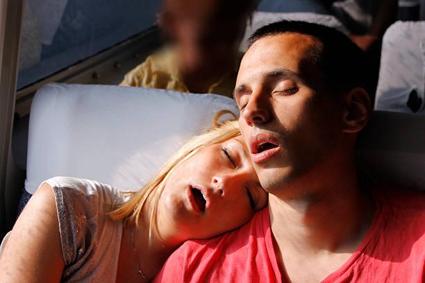 sleeping on shoulder - bahn bus stock-fotos und bilder