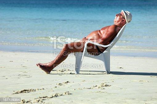 istock Sleeping on the beach 157729354