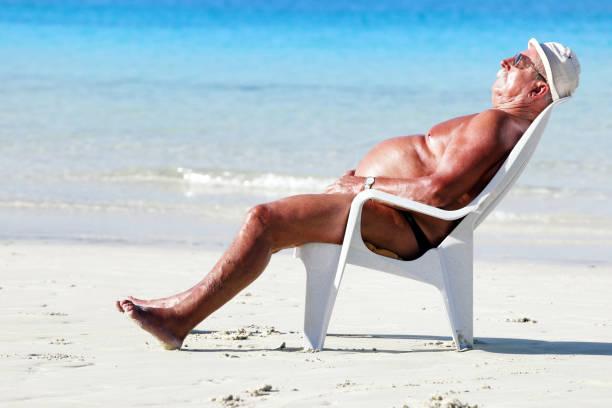 Sleeping on the beach stock photo