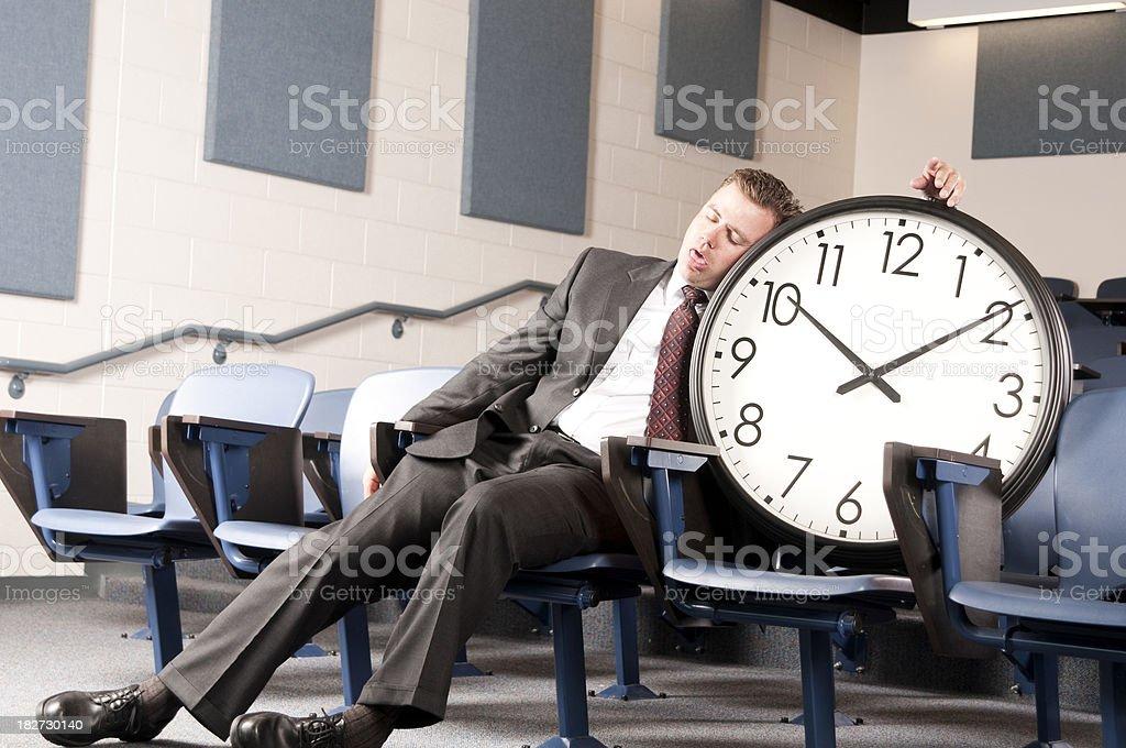 Sleeping on the clock royalty-free stock photo