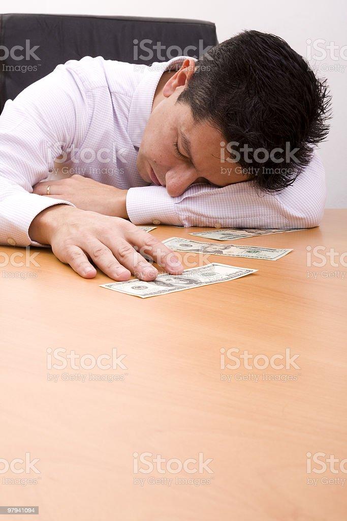Sleeping over the money royalty-free stock photo