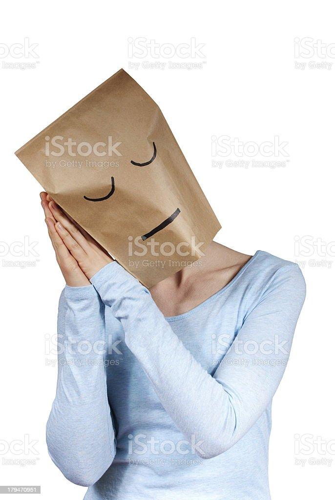 sleeping paper bag head stock photo