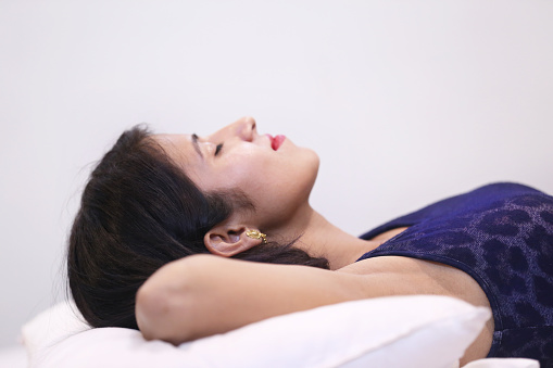 Young teenage girl sleeping peacefully at home.