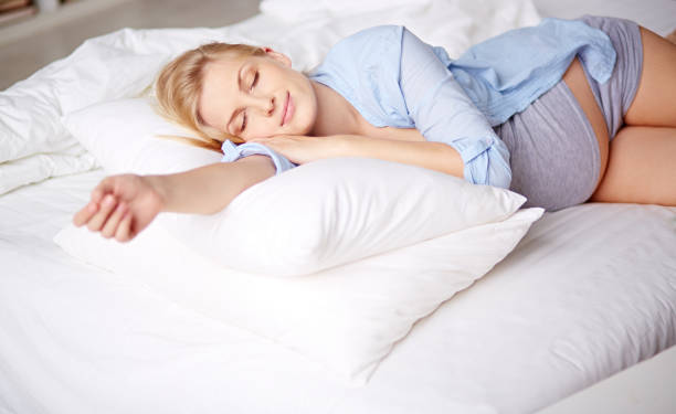 Sleeping pregnant beauty stock photo