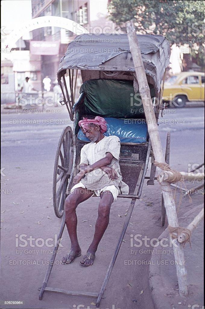 Sleeping Rickshaw Driver, Delhi, India stock photo