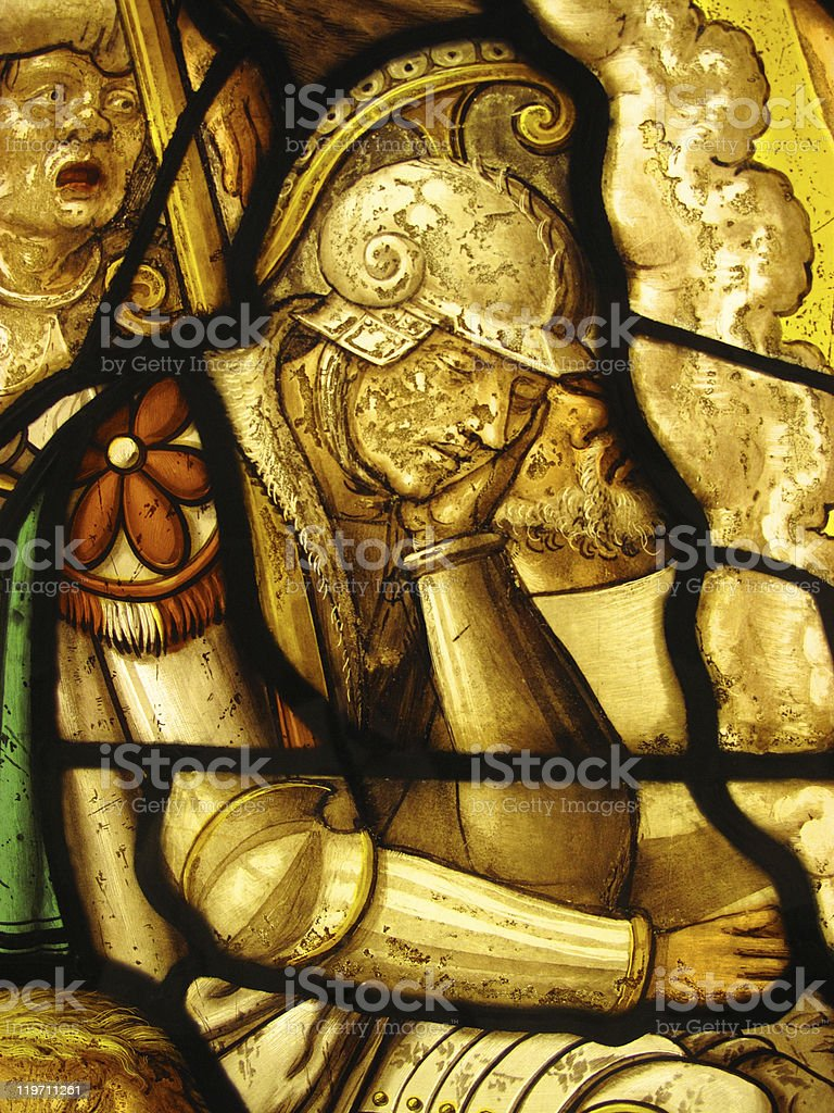 Sleeping Roman Soldier Guarding Tomb of Christ Stained Glass Window stock photo