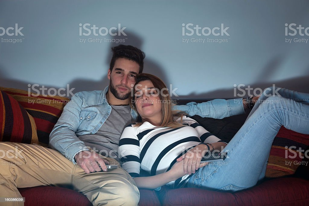 Sleeping while whatching tv stock photo