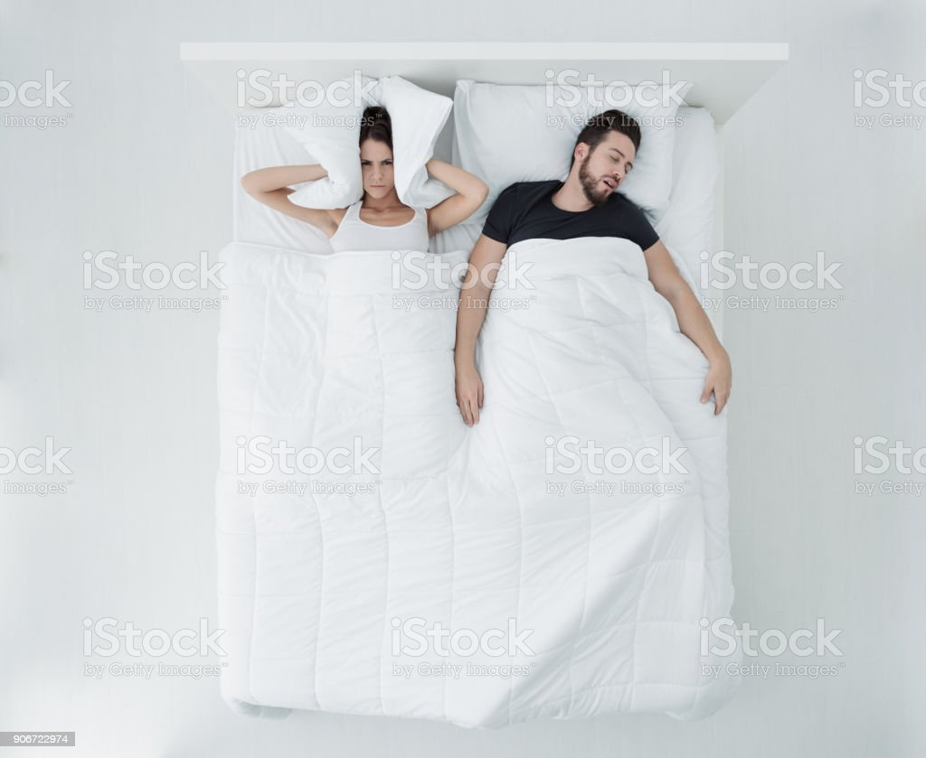 Sleeping with a snorer stock photo