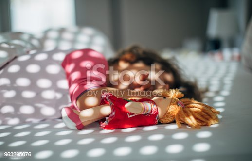 1008826222istockphoto Sleeping with doll 963295076
