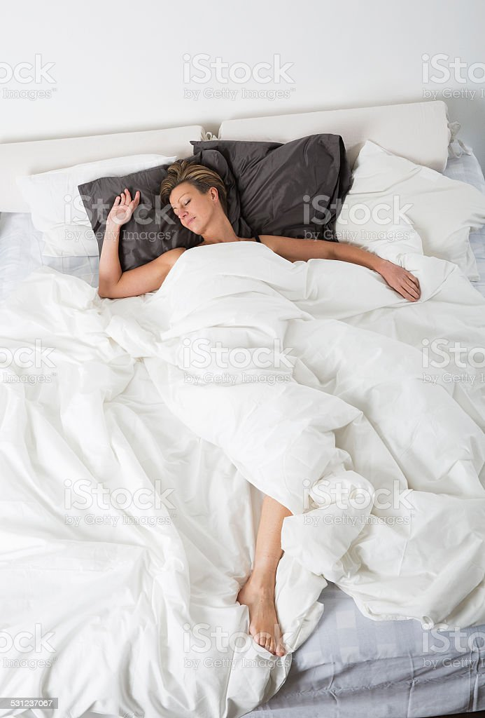 Sleeping woman from high angle view stock photo