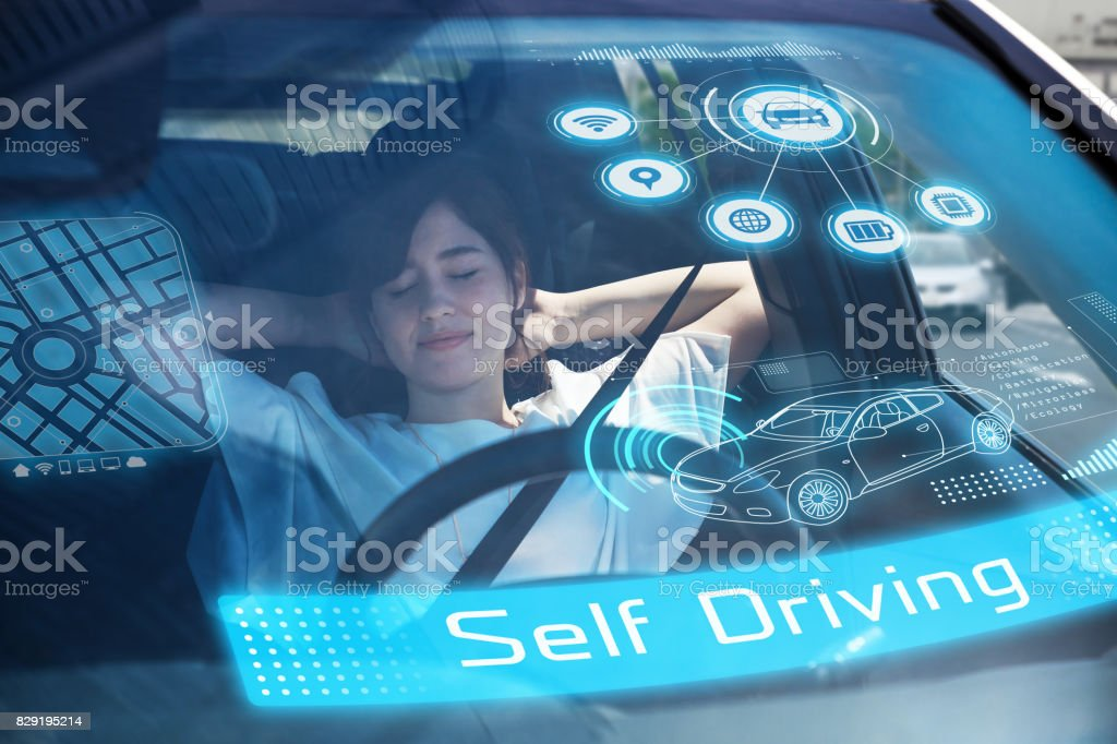 sleeping woman in autonomous car. Driverless car. Self-Driving car. UGV (unmanned ground vehicle). stock photo