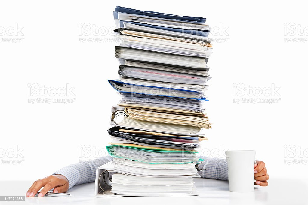 Sleeping worker behing high pile of paperwork royalty-free stock photo