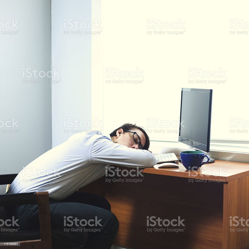 Sleeping Young Businessman At Work royalty-free stock photo