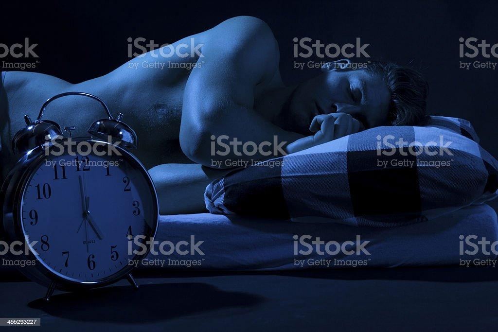 Sleeping young man foto