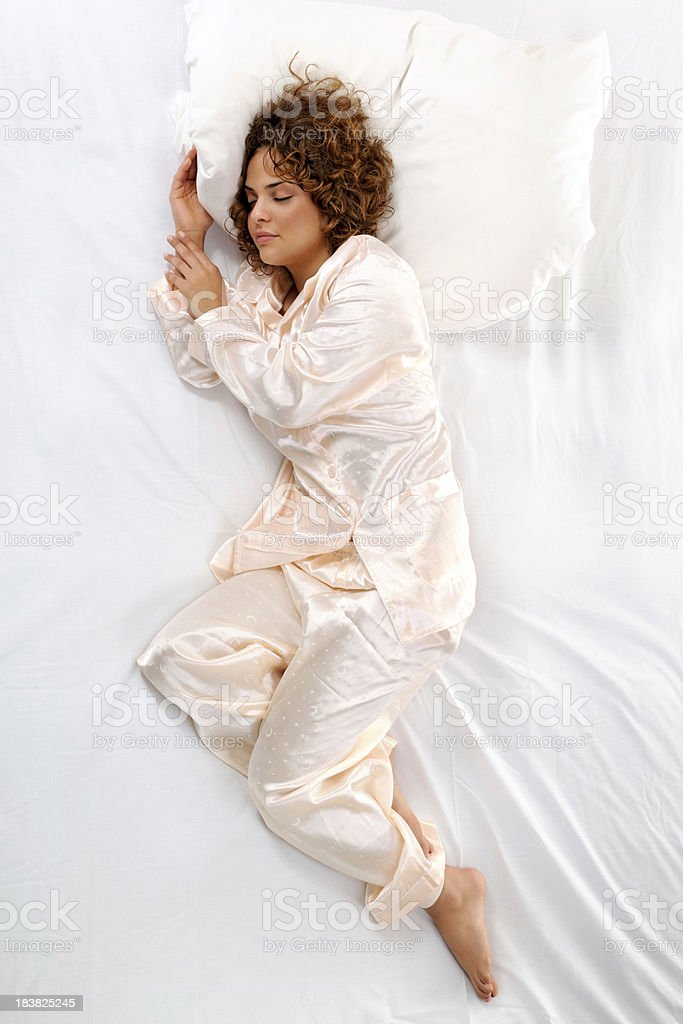 Sleeping young woman directly above stock photo